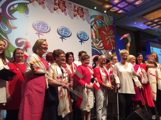 Polish delegates invite Summit participants to Poland during the 2015 Global Summit of Women in Sao Paolo.